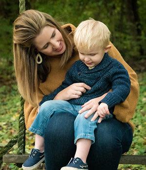 Child sitting on woman's lap